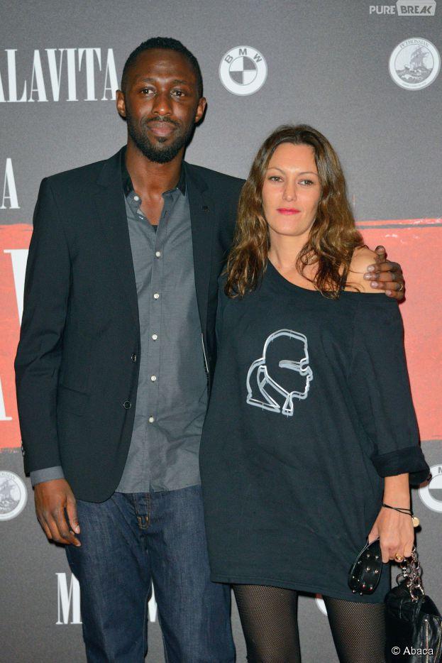 Thomas Ngijol et sa compagne Karole Rocher à l'avant-première de Malavita, le 16 octobre 2013