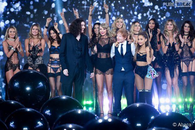 Ed Sheeran entouré de Taylor Swift et Ariana Grande pendant le défilé Victoria's Secret, le 2 décembre 2014 à Londres
