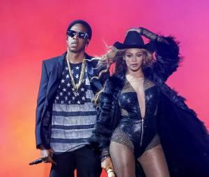 """Jay-Z et Beyoncé sur scène lors de la tournée """"On The Run"""" en 2014."""