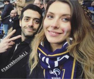 Tarek Boudali et Camille Cerf s'affichent ensemble lors du match France/Colombie le 23 mars