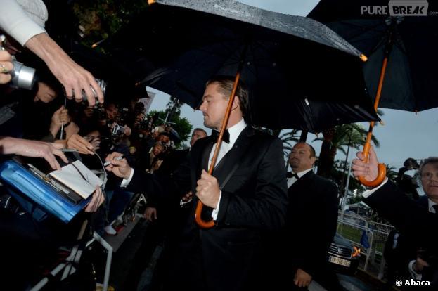 Leonardo DiCaprio sous la pluie pour la projection de Gatsby le Magnifique au Festival de Cannes 2013