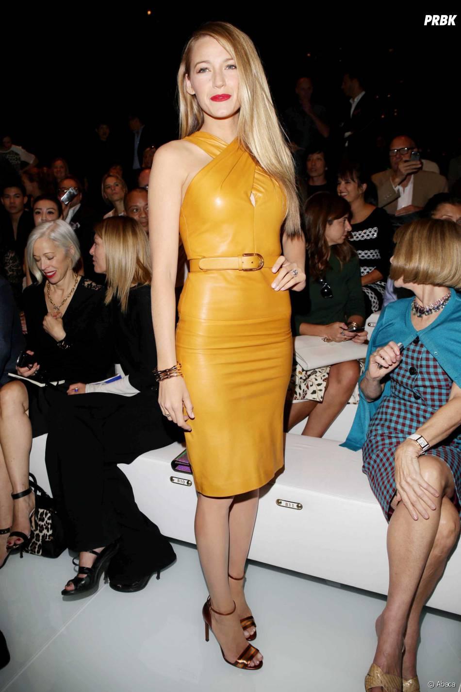 Blake Lively pose au défilé Gucci lors de la Fashion Week de Milan le 18 septembre 2013