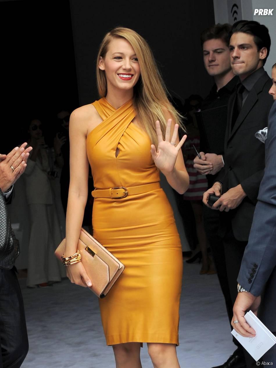 Blake Lively souriante au défilé Gucci lors de la Fashion Week de Milan le 18 septembre 2013