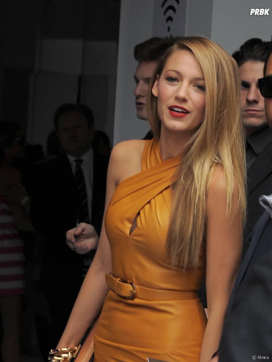 Blake Lively présente au défilé Gucci lors de la Fashion Week de Milan le 18 septembre 2013