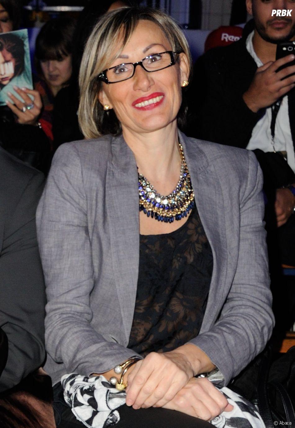 """Sophie Marthe, la mère de Shy'm, au défilé """"As i Am"""" de sa fille en 2014."""