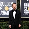 Jude Law sur le tapis rouge des Golden Globes 2018 le 7 janvier à Los Angeles