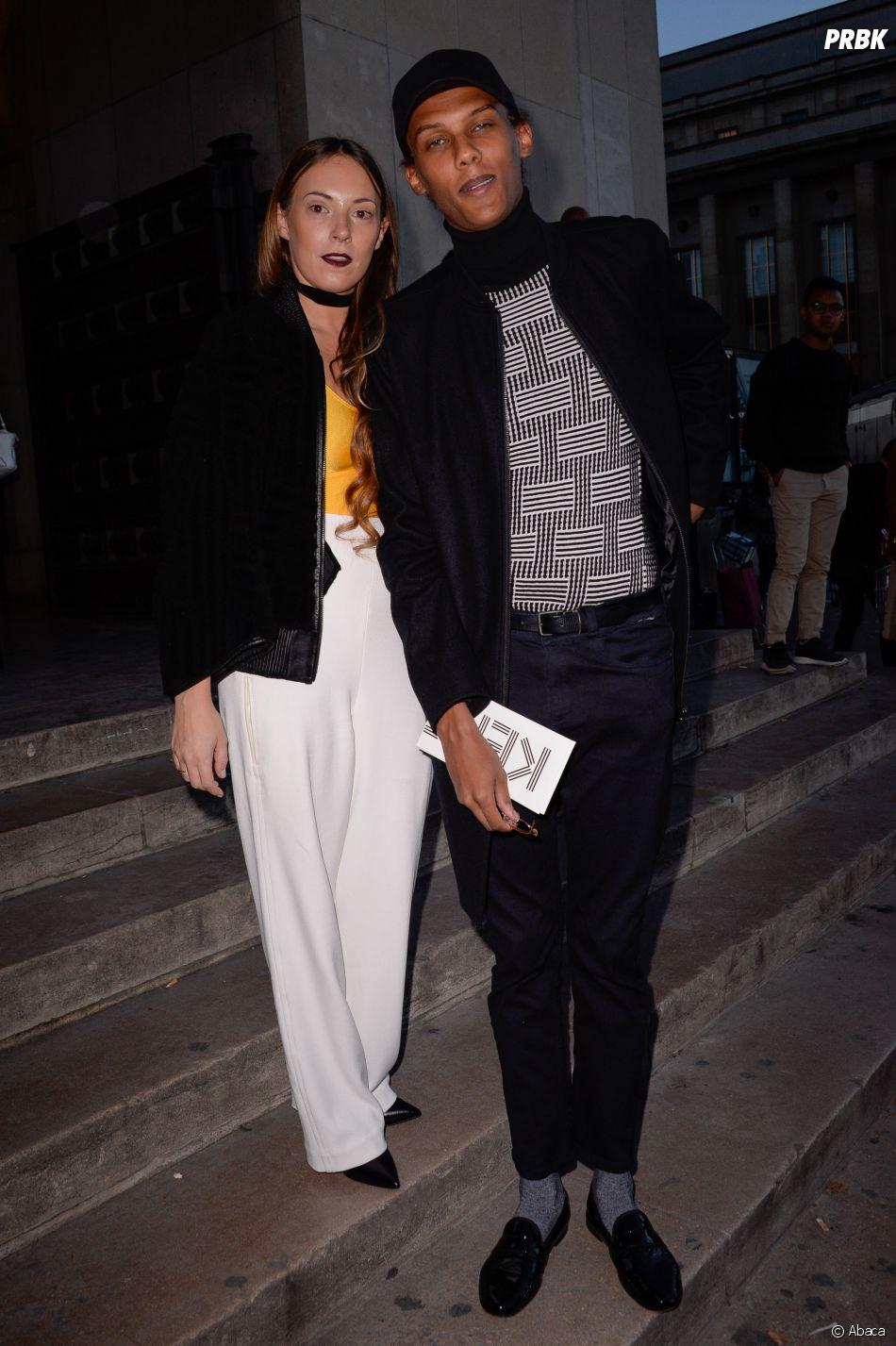 Stromae et sa femme Coralie au défilé Kenzo.