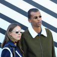 Stromae et sa femme Coralie au défilé Louis Vuitton.