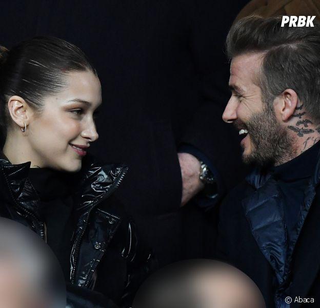 David Beckham et Bella Hadid très proches et complices dans les gradins du match PSG-Real Madrid.