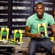 """Usain Bolt à Londres pour la promo de """"Faster Than Lightning : My Autobiography"""", le 19 septembre 2013"""