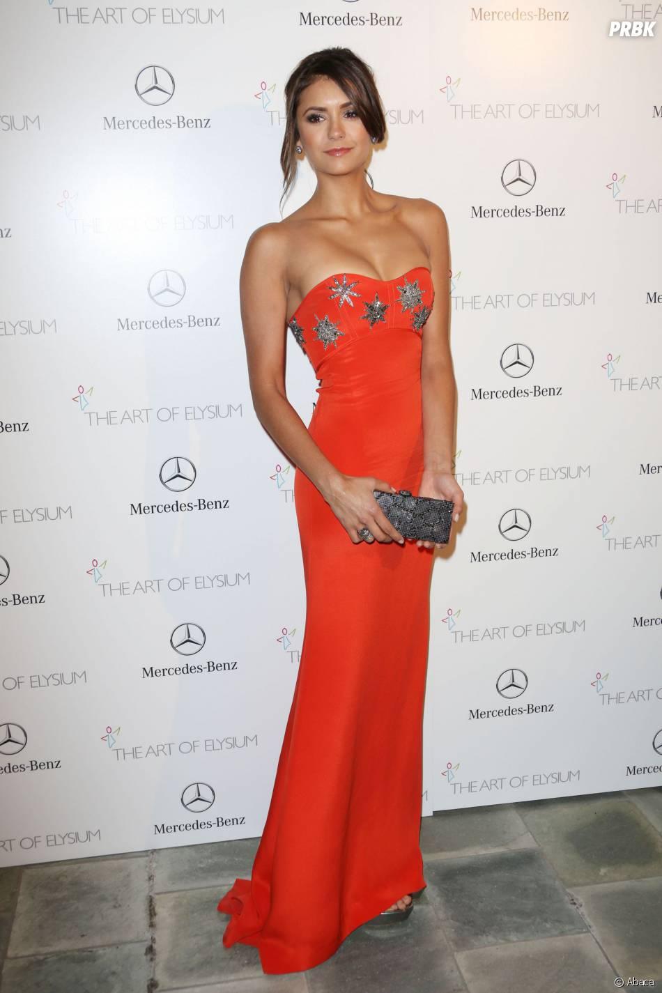 Nina Dobrev décolletée et élégante à l'Art of Elyisum Heaven Gala, le 11 janvier 2014 à Los Angeles
