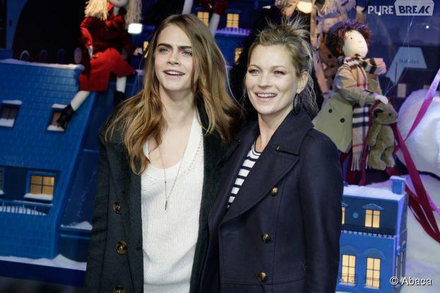 Cara Delevingne et Kate Moss tout sourire au Printemps pour dévoiler les vitrines de Noël le 6 novembre 2014