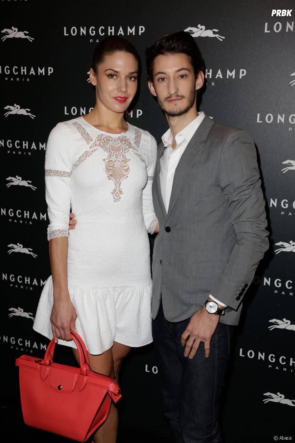 Pierre Niney et sa compagne à l'ouverture de la boutique Longchamp sur les Champs Elysées à Paris, le 4 décembre 2014