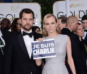 Diane Kruger et Joshua Jackson : Je suis Charlie sur le tapis rouge des Golden Globes 2015, le 11 janvier 2015 à Los Angeles