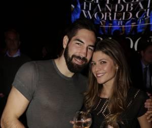 Nikola Karabatic et Géraldine Pillet au VIP Room pour fêter la victoire de l'équipe de France de handball au championnat du monde 2015, le 2 février 2015