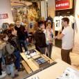 Cyprien Iov discute avec ses fans lors de l'ouverture de sa boutique au Citadium Paris Caumartin à Paris le 27 avril 2015