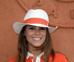 Karine Ferri en orange au village Roland Garros le 27 mai 2014