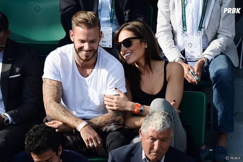 M. Pokora proche d'une jeune femme à Roland Garros le lundi 2 juin 2014