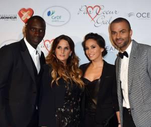Omar Sy et Hélène, Tony Parker et Axelle sur le tapis rouge du gala Par Coeur au profit de l'association Cé Ke Du Bonheur à Paris, le 24 septembre 2015