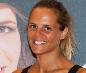 """Laure Manaudou tout sourire pour la présentation de """"Laure Manaudou Design"""" à Paris le samedi 6 juillet 2013"""