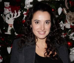 Isabelle Vitari souriante au Musée Grévin, le 20 novembre 2013