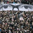 Le regard de Charb lors de la marche républicaine contre le terrorisme à Paris, le 11 janvier 2014
