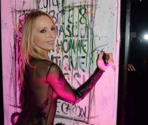 Tonya Kinzinger sexy : transparente pour célébrer les 80 ans du parfum Pour Un Homme, le 9 octobre 2014 à Paris