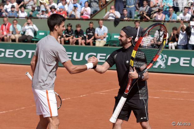 Cyril Hanouna et Novak Djokovic lors de la journée des enfants à Roland Garros, le 23 mai 2015