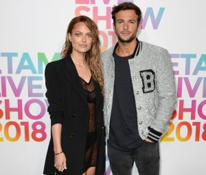 Caroline Receveur et Hugo Philip au défilé Etam, ce mardi 25 septembre 2018 à Paris.