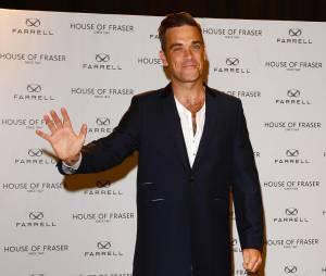 """""""Non, non, pas de photos !"""". Pourquoi tu te mets sur le tapis rouge aussi Robbie Williams ?"""