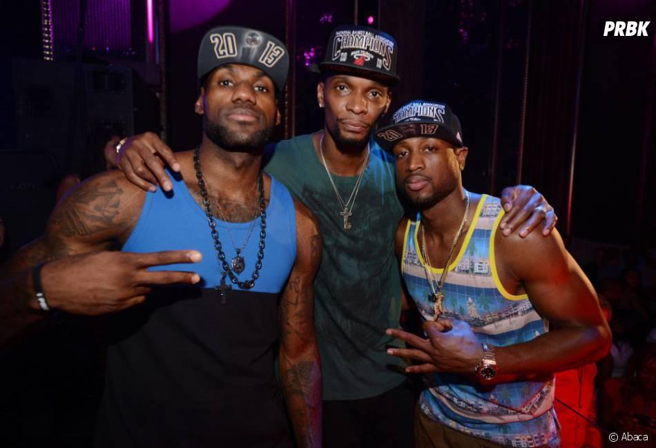 LeBron James, Chris Bosh et Dwyane Wade fêtent la victoire des Miami Heat en NBA le 22 juin 2013