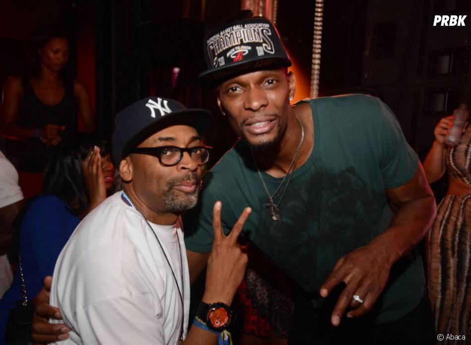 Spike Lee et Chris Bosh fêtent la victoire des Miami Heat en NBA le 22 juin 2013