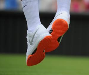 Les semelles oranges de Roger Federer à Wimbledon 2013