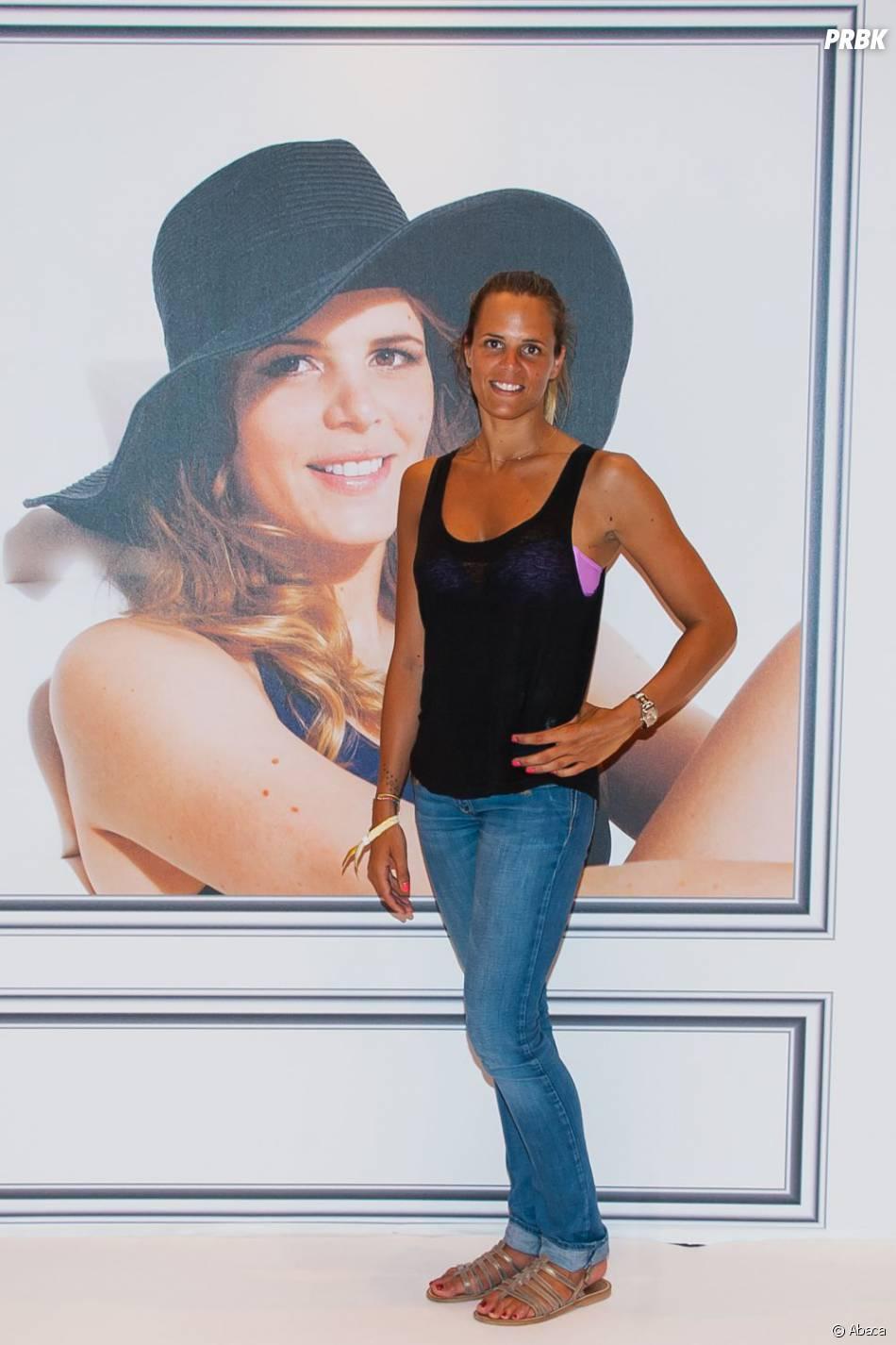 Laure Manaudou bronzéeà Paris le samedi 6 juillet 2013