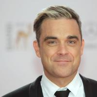 """Robbie Williams : """"Je suis homosexuel à 49%"""""""