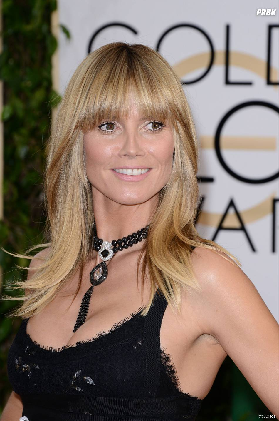 Heidi Klum ose la frange sur le tapis rouge des Golden Globes 2014
