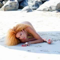 Afida Turner sexy et à moitié nue sur la plage avant le Festival de Cannes 2015