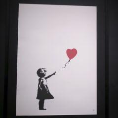 Banksy : une peinture vendue 1,2 millions d'euros... s'auto-détruit en direct 😱