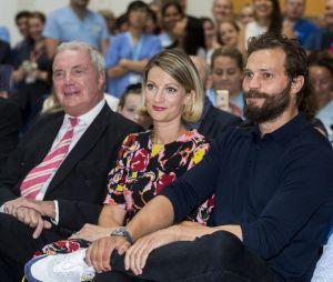 Jamie Dornan avec son père Jim Dornan et sa soeur Jessica Dornan à un événement de charité contre le cancer