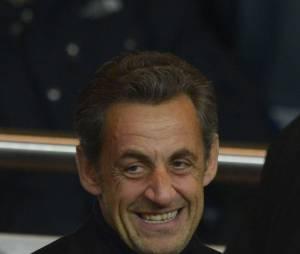 Nicolas Sarkozy grand sourire malgré sa mise en examen, au parc des Princes le 29 mars 2013