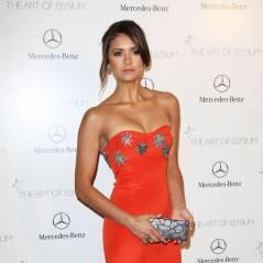 Nina Dobrev décolletée et élégante sur le tapis rouge de l'Art of Elysium Heaven Gala 2014