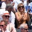 Enora Malagré détendue sous le soleil au tournoi de Roland Garros, le samedi 31 mai 2014