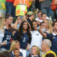Les femmes des Bleus dans les gradins, lors du match de l'équipe de France contre l'Equateur au Mondial 2014, le 25 juin 2014