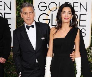George Clooney et sa femme, Amal Alamuddin, sur le tapis rouge des Golden Globes, le 11 janvier 2015 à Los Angeles