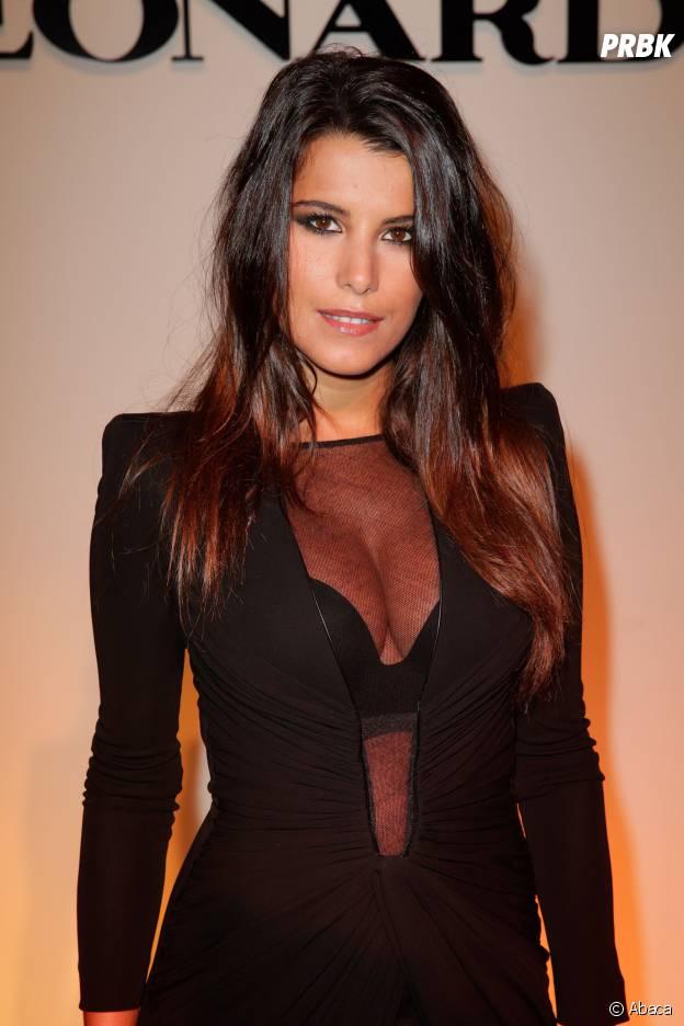 Karine Ferri : sexy et décolletée, le 30 septembre 2013 à la Fashion Week de Paris