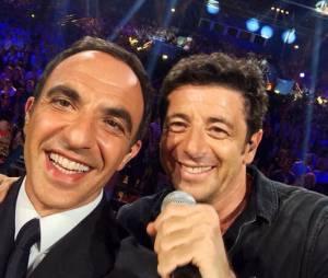 Nikos Aliagas et Patrick Bruel lors de la soirée La Chanson de l'année 2014, le 14 juin sur TF1