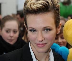 """Lorie pendant la conférence de presse de l'opération """"Pièces jaunes"""", en 2011"""